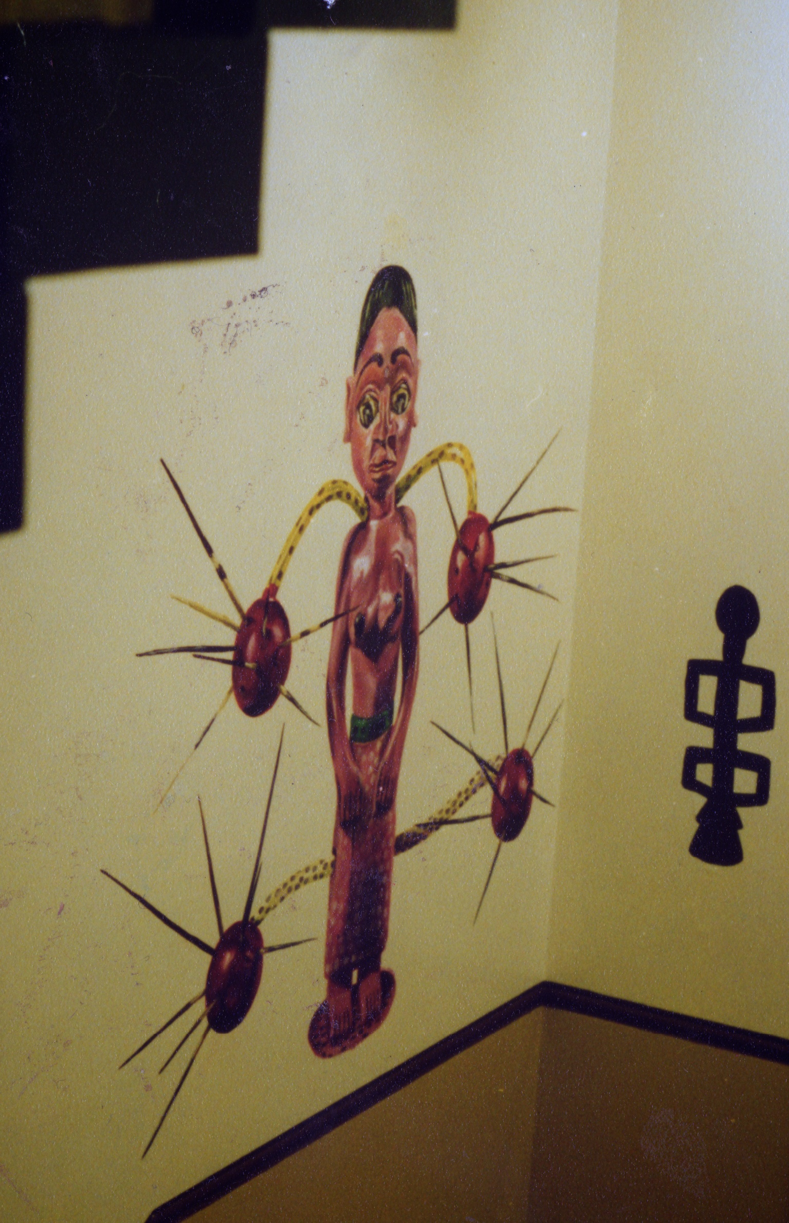 murals of a West African sculpture